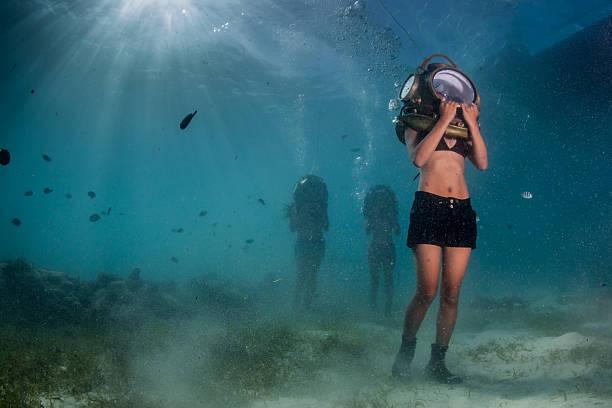 diving trying out sea floor walking in an underwater helmet